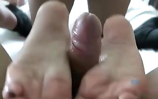 Brunette Babe Gives a Kinky Foot Job - Watch Part2 on PORNAVA.COM