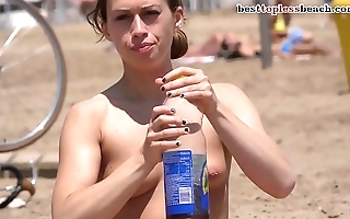 Beautiful babe Topless on the Beach