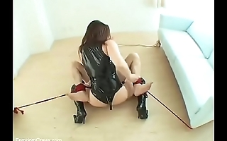 Japanese mistress in latex dominating a slave