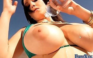 Busty babes oil up tits
