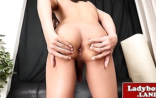 Solo ladyboy wanks and teases with her botheration