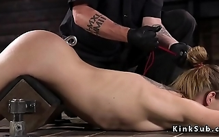 Brunette slave gets anal hook in dungeon