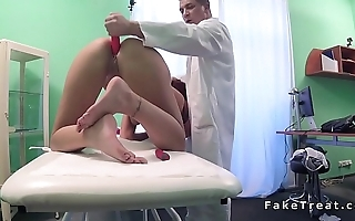Redhead masturbates with dealings toy in hospital