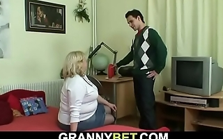 Grandma with huge boobs rides his young cock