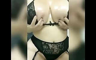 Giant  natural boobs getting oiled up