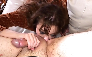 Submissive slut in jeans gags on master's hard cock
