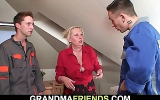 Two repairmen fuck big tits grandma